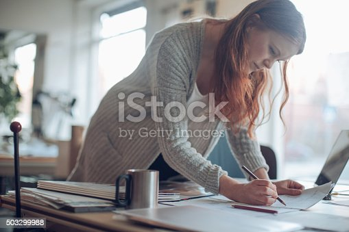 506821756 istock photo Young woman working on a project 503299988