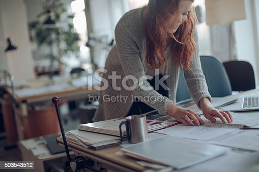 506821756 istock photo Young woman working on a project 503543512