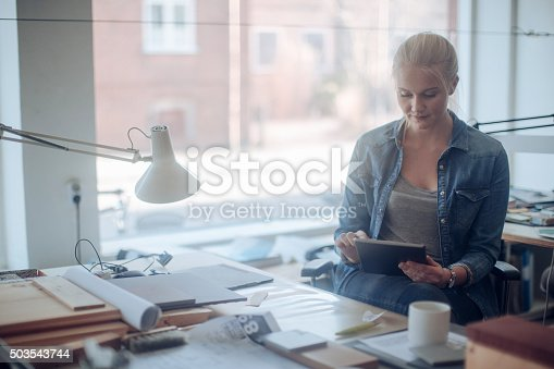 506821756 istock photo Young woman working on a project 503543744