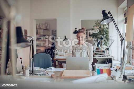506821756 istock photo Young woman working on a project 503586932