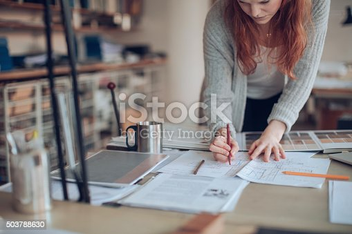 506821756 istock photo Young woman working on a project 503788630