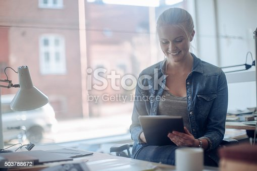 506821756 istock photo Young woman working on a project 503788672