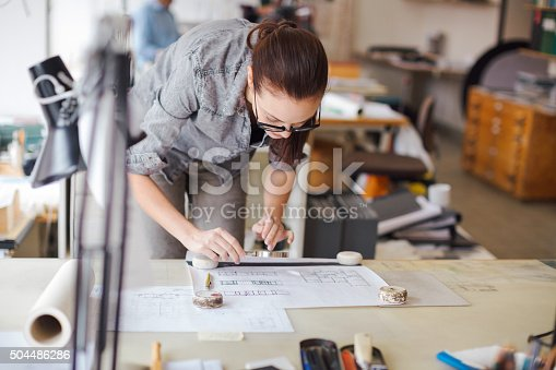 506821756 istock photo Young woman working on a project 504486286
