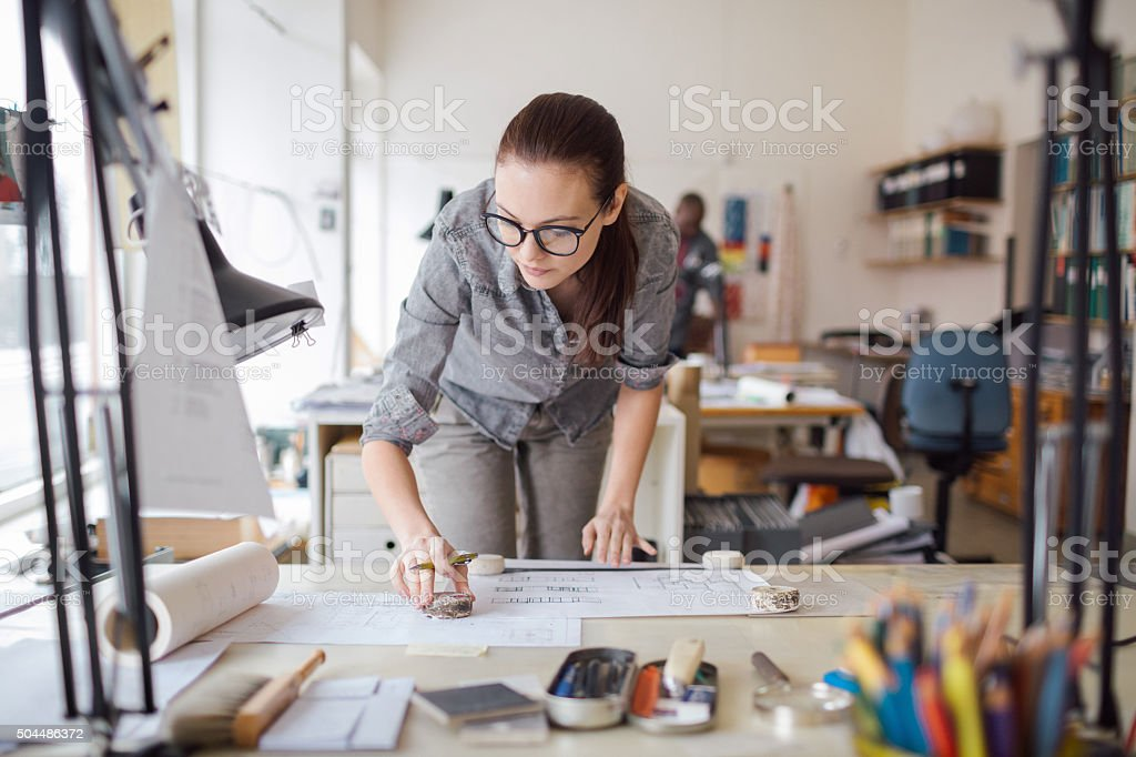 Young woman working on a project royalty-free stock photo