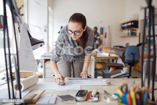 506821756 istock photo Young woman working on a project 504486372