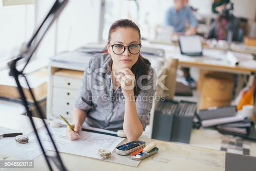 506821756 istock photo Young woman working on a project 504892012