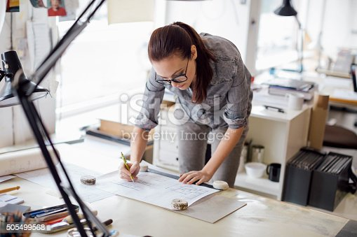 506821756 istock photo Young woman working on a project 505499568