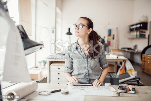 506821756 istock photo Young woman working on a project 506821246