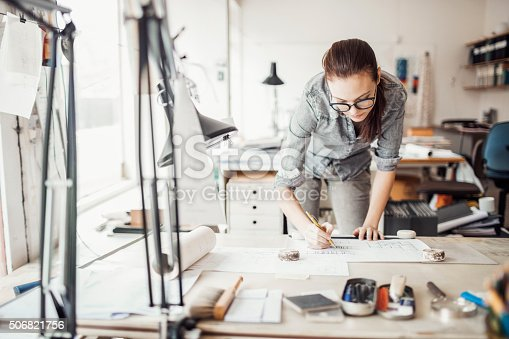 istock Young woman working on a project 506821756