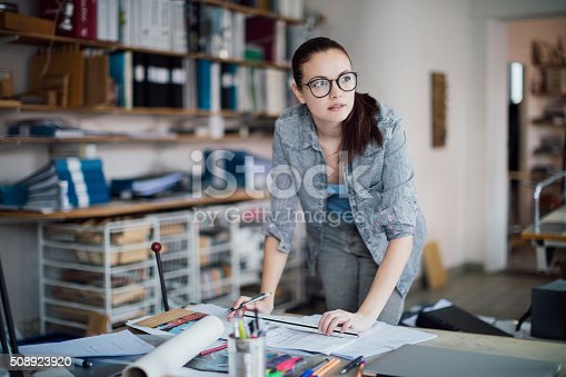 506821756 istock photo Young woman working on a project 508923920