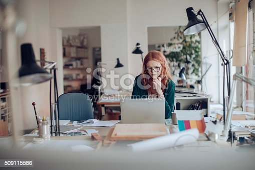 506821756 istock photo Young woman working on a project 509115586