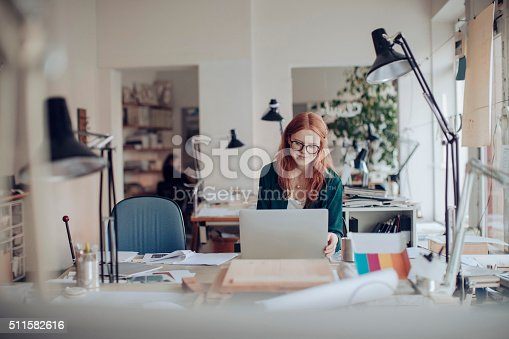 istock Young woman working on a project 511582616