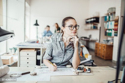 506821756 istock photo Young woman working on a project 514066414