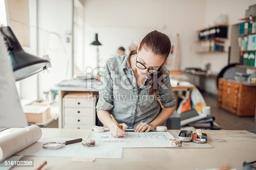 506821756 istock photo Young woman working on a project 516102398