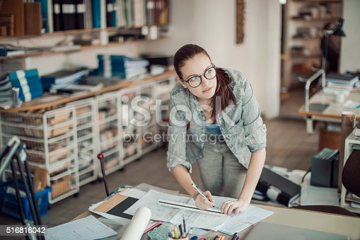 506821756 istock photo Young woman working on a project 516816042