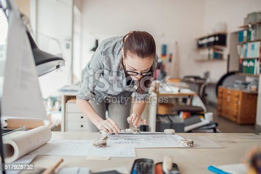 506821756 istock photo Young woman working on a project 517928732