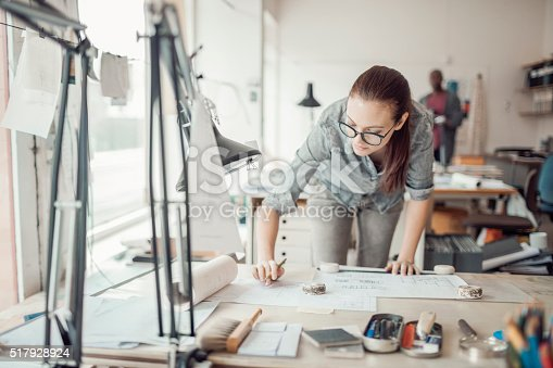 506821756 istock photo Young woman working on a project 517928924