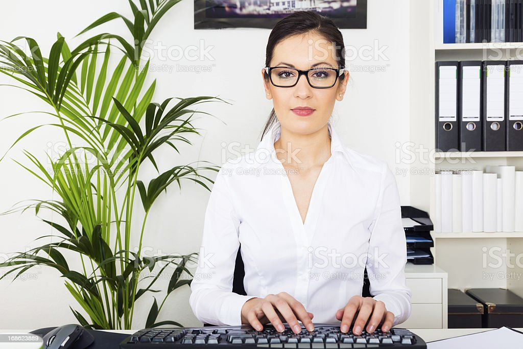 young woman working on her computer royalty-free stock photo