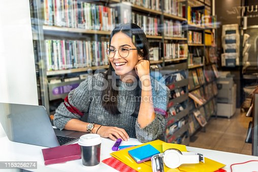 istock young woman working on her laptop in the library 1153256274
