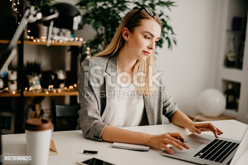 1031394390istockphoto Young woman working on her new project 892696620