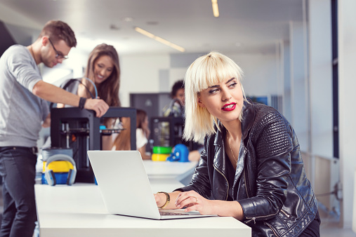 Young Woman Working On Laptop In 3d Printer Office Stock Photo - Download Image Now