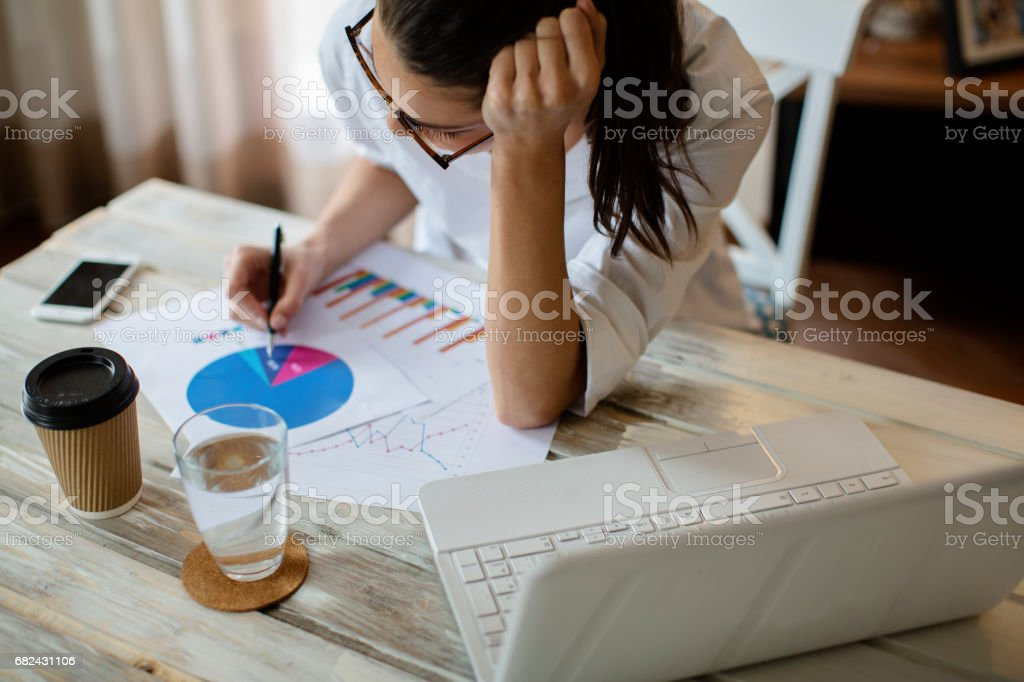 Young woman working on the new project royalty-free stock photo
