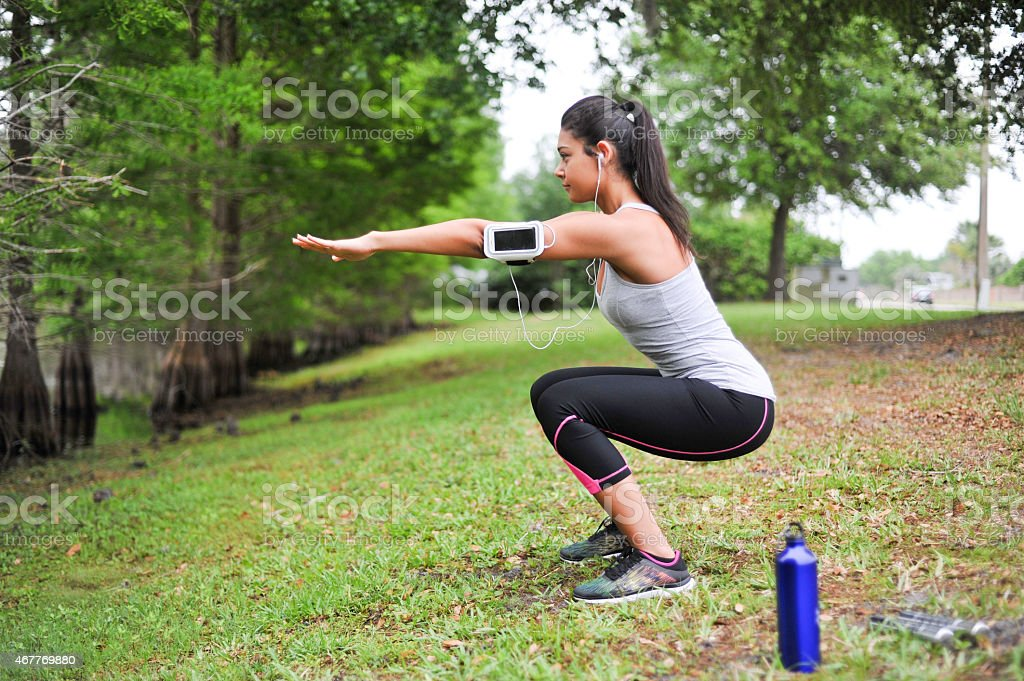 Young Woman working out in a peaceful environment stock photo