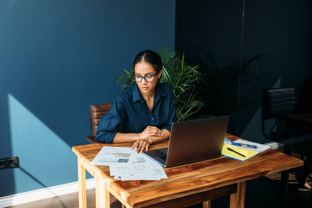 Young woman working with documents from home stock photo