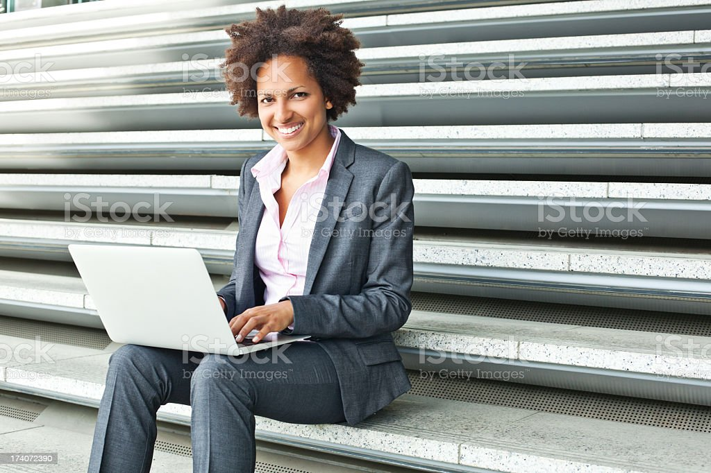 Young woman working with laptop royalty-free stock photo