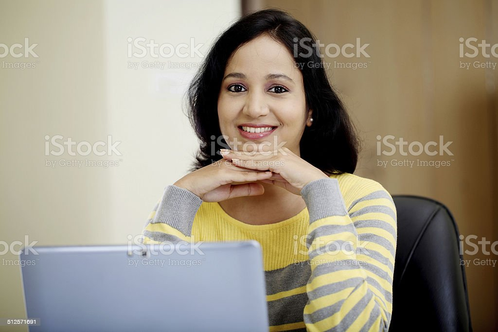 Young woman working with tablet computer stock photo