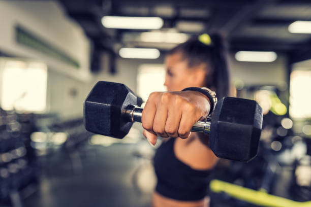 young woman workout in gym healthy lifestyle - dumbbell stock pictures, royalty-free photos & images