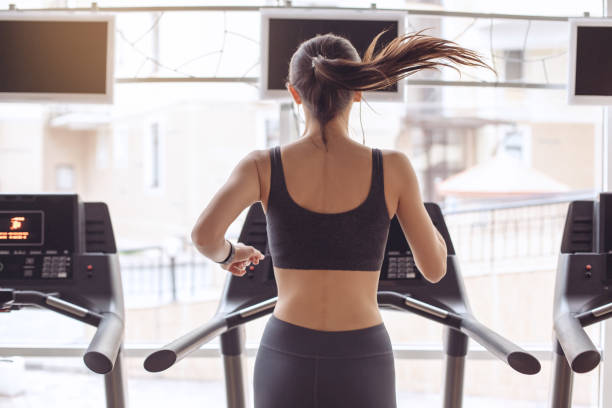 young woman workout in gym healthy lifestyle - treadmill stock photos and pictures