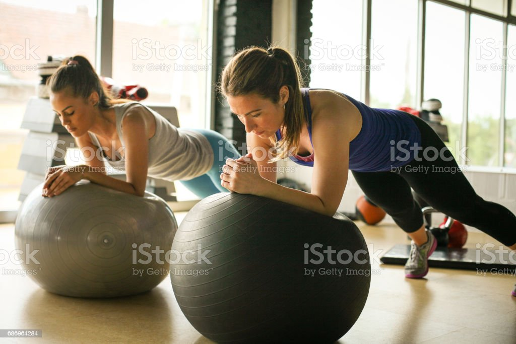 Young woman workout in healthy club. Young woman on Pilates ball. royalty-free stock photo