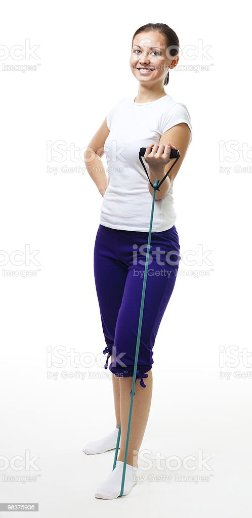 Young woman workout with expander royalty-free stock photo