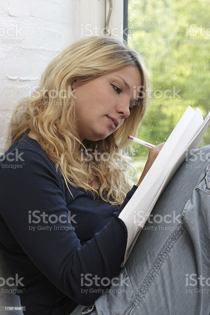 Young woman writing royalty-free stock photo