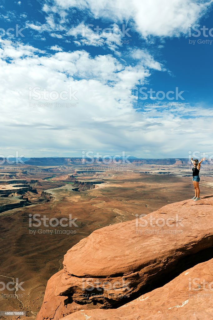 Young Woman,Hands raised, Enjoying View of Grand Canyon USA stock photo