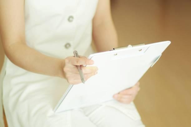 若い女性のアロマセラピストのカウンセリング患者 ストックフォト