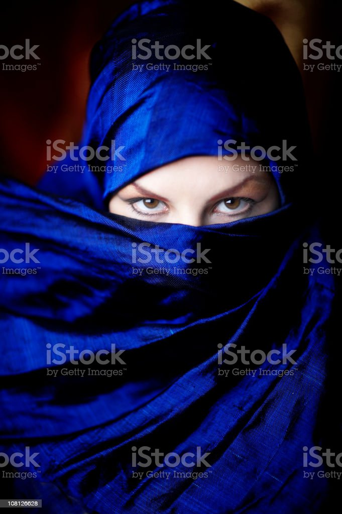 Young Woman's Face Covered in Scarf With Eyes Showing royalty-free stock photo