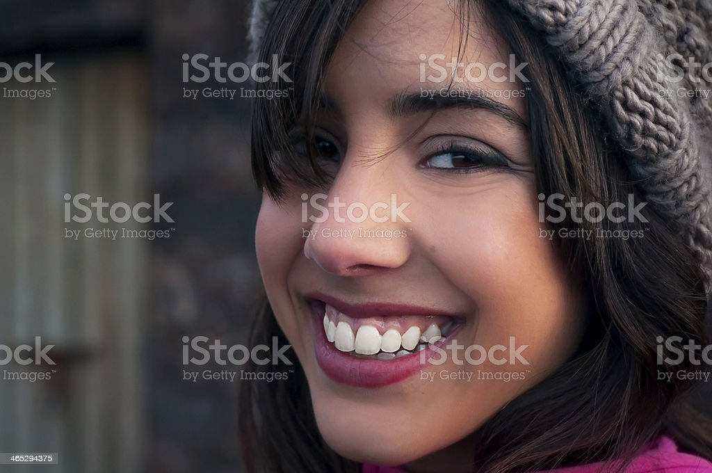 Young woman's face with a big smile stock photo