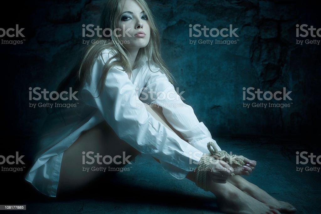 Young Woman's Hands and Feet Tied with Rope royalty-free stock photo
