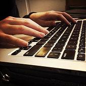 istock Young Woman's Hands on MacBook Pro Laptop Computer 501762588