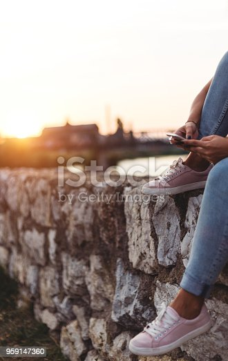 855341616istockphoto Young woman`s hands using smartphone 959147360