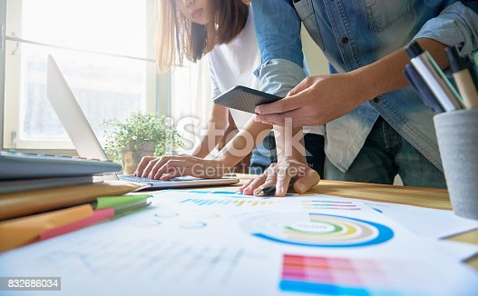 861940002 istock photo Young women and man are shopping online on laptop in my home. By payment online. Modern technology concept makes life easy, vintage effect. 832686034