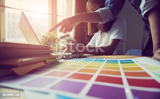 861940002 istock photo Young women and man are shopping online on laptop in my home. By payment online. Modern technology concept makes life easy, vintage effect. 842685108
