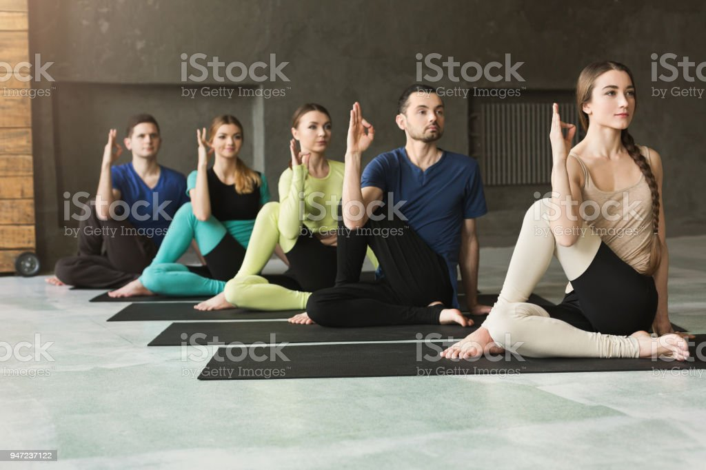 Young Women And Men In Yoga Class Relax Meditation Pose Royalty Free Stock Photo