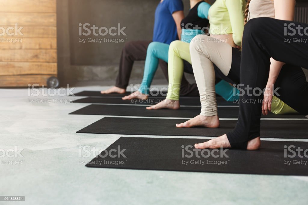 Young women and men in yoga class, relax meditation pose royalty-free stock photo