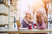 Group of young women are having fun in a coffee shop
