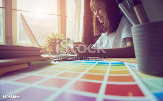 861940002 istock photo Young women are shopping online on laptop in my home. By credit card payment. Modern technology concept makes life easy, vintage effect. 832683844