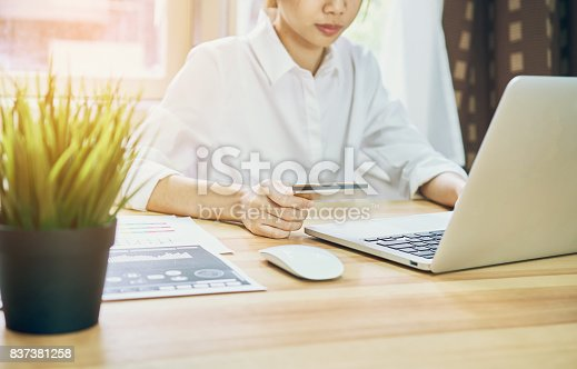 861940002 istock photo Young women are shopping online on laptop in my home. By credit card payment. Modern technology concept makes life easy, vintage effect. 837381258