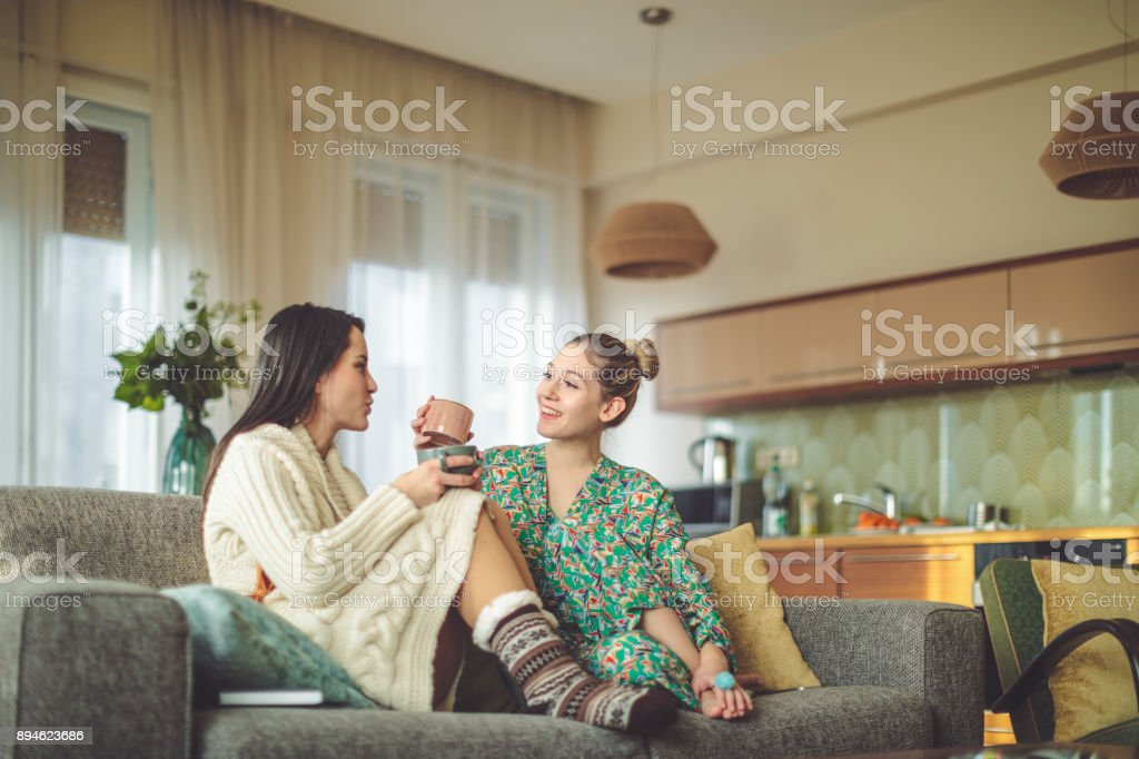 Young women at home stock photo